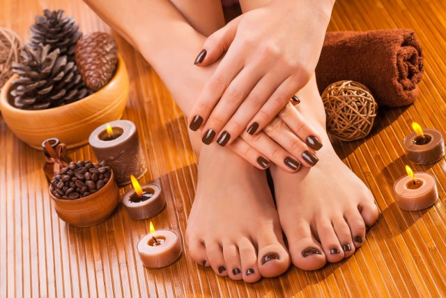 beautiful brown manicure and pedicure on the bamboo